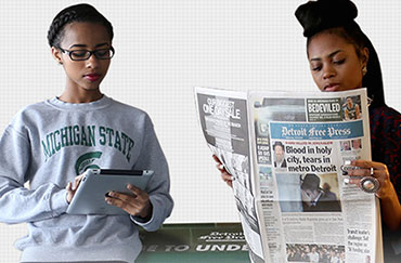students reading newspaper